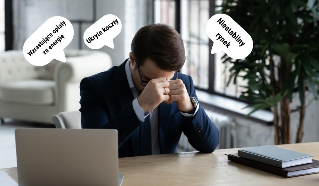 mężczyzna zastanawiający się nad zmianą sprzedawcy energii w firmie